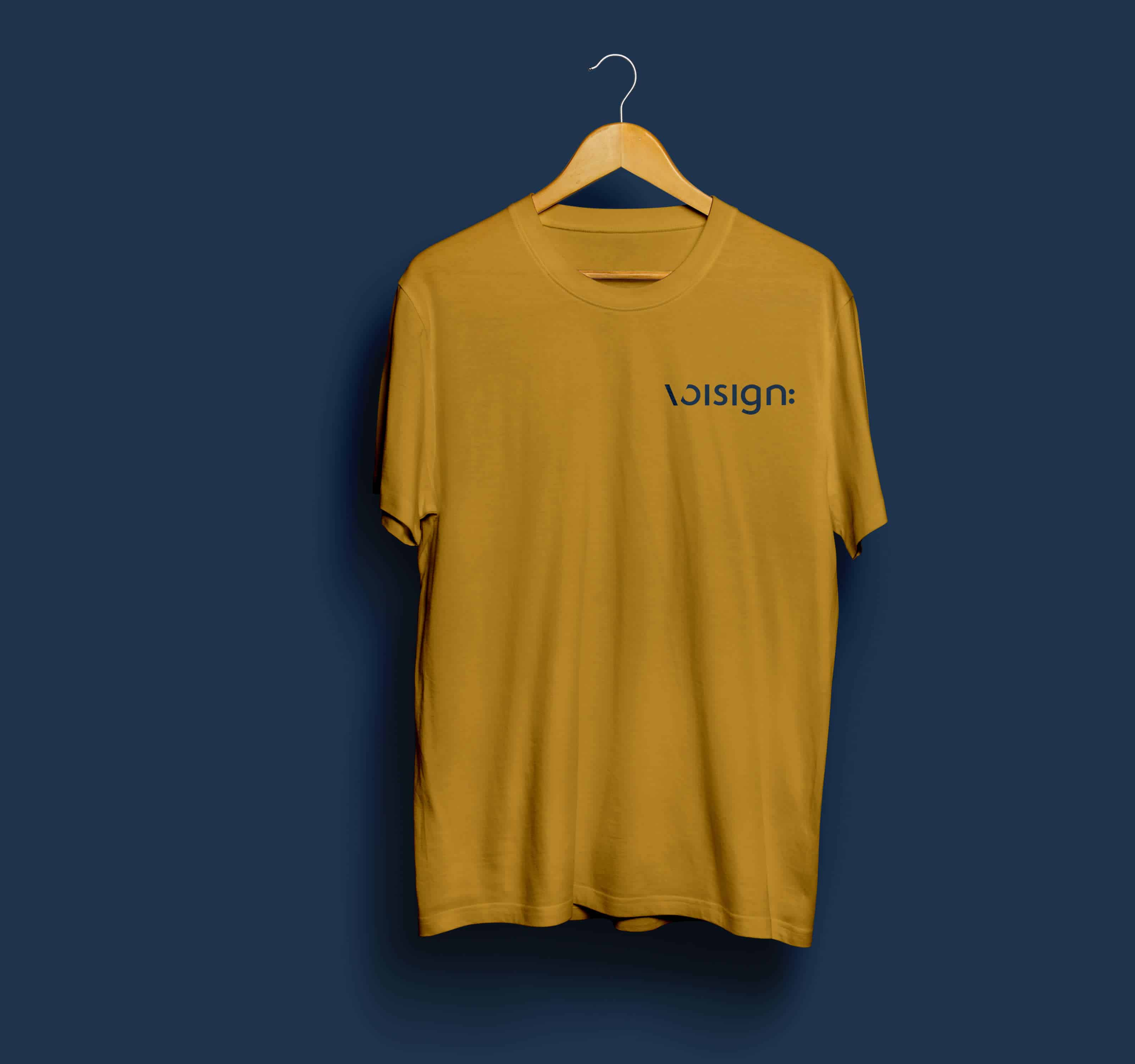 Mockup of Voisign seaweed coloured primary logo design on an golden coloured tshirt
